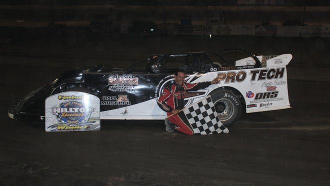 Holmes Tire late model driver Freddie Carpenter in victory lane on Friday at Hilltop Speedway.