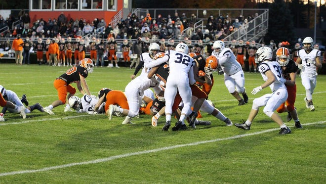 Sault High's Emmett Fazzari (32) gets in on a tackle during a game at Kingsley Friday night. The Stags downed the Blue Devils 40-6.