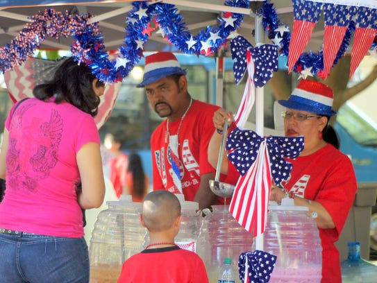 Agua fresca was a cooling-off spot for many of the Fourth of July visitors to the Courthouse Park.