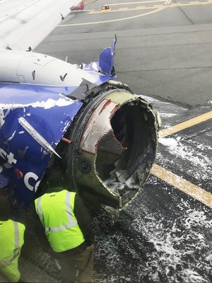 A handout photo made available by Instagram user ABOURMAN shows the damaged engine of Southwest Airlines Flight 1380, which was en route from LaGuardia Airport in New York City to Love Field in Dallas on April, 17, 2018.