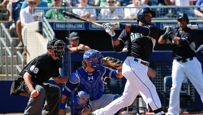 Seattle Mariners second baseman Robinson Cano drives a double off the center field fence against the Los Angeles Dodgers in a spring training baseball game Sunday, March 15, 2015, in Peoria, Ariz.