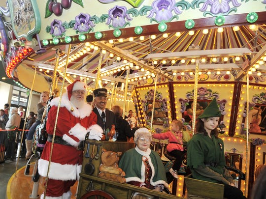 Mr. and Mrs. Claus take a ride on Salem's Riverfront Carousel during a visit  in 2010. Santa arrives aboard the Carousel Express this year on Nov. 27.