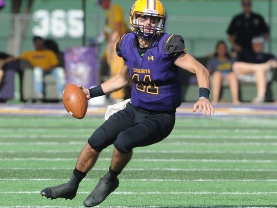 HSU quarterback Landry Turner looks for running room