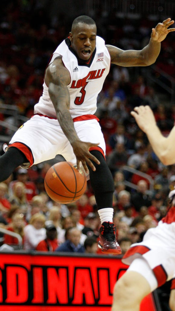 Louisville's Chris Jones drives into the paint in the