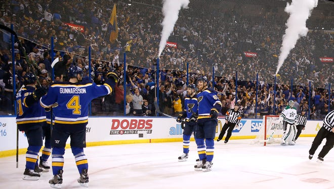 St. Louis Blues' Vladimir Tarasenko, far left, of Russia, is congratulated by teammates after scoring during the second period of Game 3 of the NHL hockey Stanley Cup Western Conference semifinals against the Dallas Stars, Tuesday, May 3, 2016, in St. Louis.
