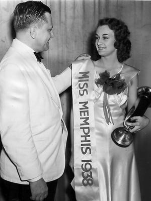 Miss Ruth Gilliam is congratulated by Public Safety Commissioner Cliff Davis after being named Miss Memphis for 1938.