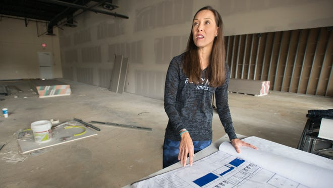 Co-owner Leah Seacrest talks Wednesday, Dec. 27, 2017, about plans for the new Regymen Fitness gym under construction on North Davis Highway in Pensacola.