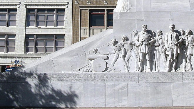 """The Alamo Cenotaph, also known as """"The Spirit of Sacrifice,"""" is a monument in San Antonio, Texas that commemorates the battle fought at the adjacent Alamo mission. A monument which bears the names of those who were known to have fought there on the Texas side are inscribed on the cenotaph."""