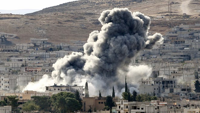 Heavy smoke rises following an airstrike by the U.S.-led coalition aircraft in Kobani, Syria, during fighting between Syrian Kurds and the militants of Islamic State group, as seen from the outskirts of Suruc, on the Turkey-Syria border, October 15, 2014.