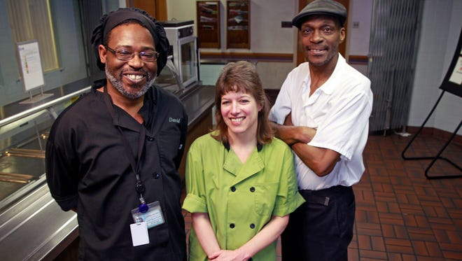 Dave McKnight (left), Lynn Lathrop and Renatto Curtis are the last remaining staff at the Journal Sentinel cafeteria, which closes Friday after serving employees more than 90 years.