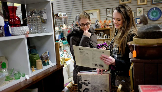 Laurie Budd looks over items with her daughter Alex Budd, 16, at Everything Classic Antiques during Small Business Saturday Nov. 29, 2014 in downtown Port Huron.