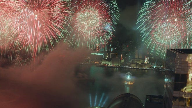Fireworks illuminate Hong Kong harbor and the Convention Center, where handover ceremonies were held, as the new Chinese establishment in Hong Kong celebrated its return to China following 156 years of British sovereignty July 1, 1997. In the middle of the harbor is a laser light ball.
