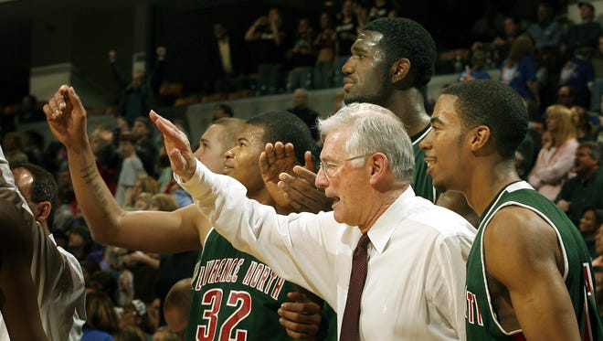 Lawrence North coach Jack Keefer, Greg Oden and Mike Conley (right) celebrate the 2006 state championship.