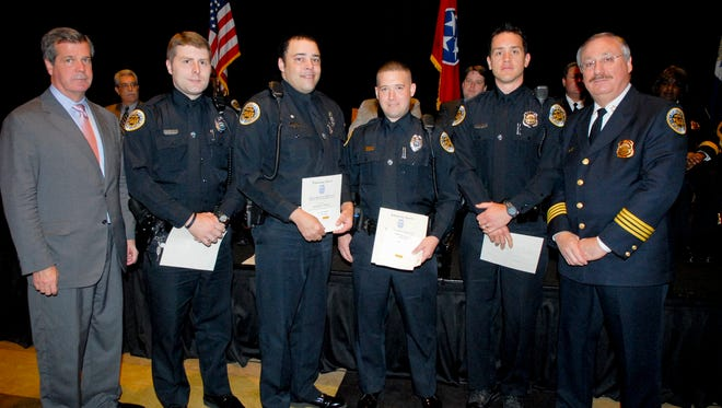 Officer Eric Mumaw, 3rd from the left, received the MNPD's Lifesaving Award on April 27, 2011.