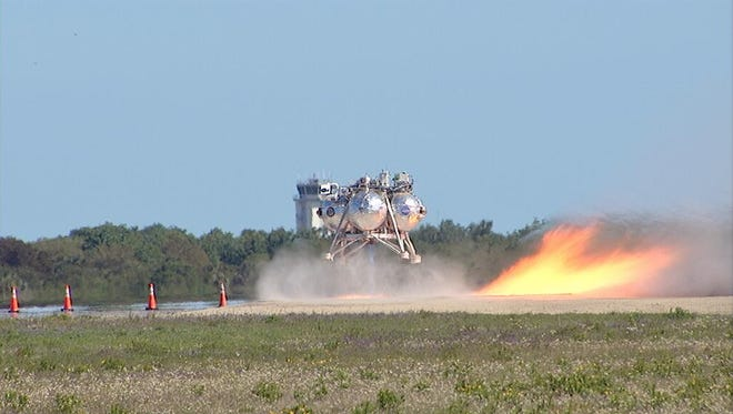 NASA's Morpheus lander is seen completing its first test with a new sensor package on Wednesday, April 2, 2014.