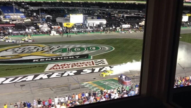 Kyle Busch does a burnout after his victory at the Kentucky Speedway.