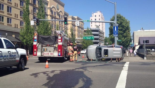 Rollover crash at Liberty and Trade in downtown Salem.