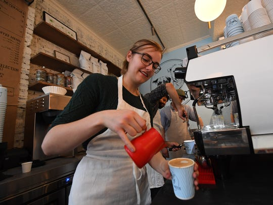 Barista Becca English preps a coffee at Boris & Horton.