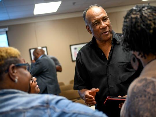 Jackson-Madison County Board of Education member Morris Merriweather speaks with supporters after a meeting last year.