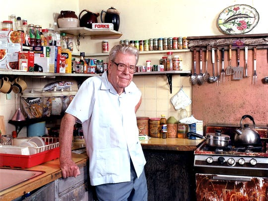 "A.E. ""Beanie"" Backus stands in the kitchen at 122 A.E. Backus Ave. in Fort Pierce. Backus, born in 1906, painted Florida landscapes."