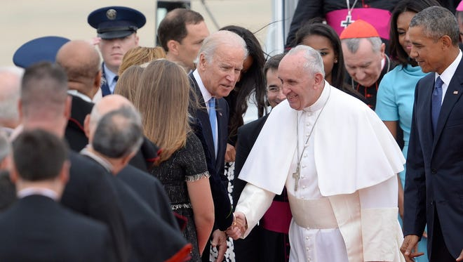 Vice President Joe Biden, a devout Catholic speaks to the pontiff as he greets others.