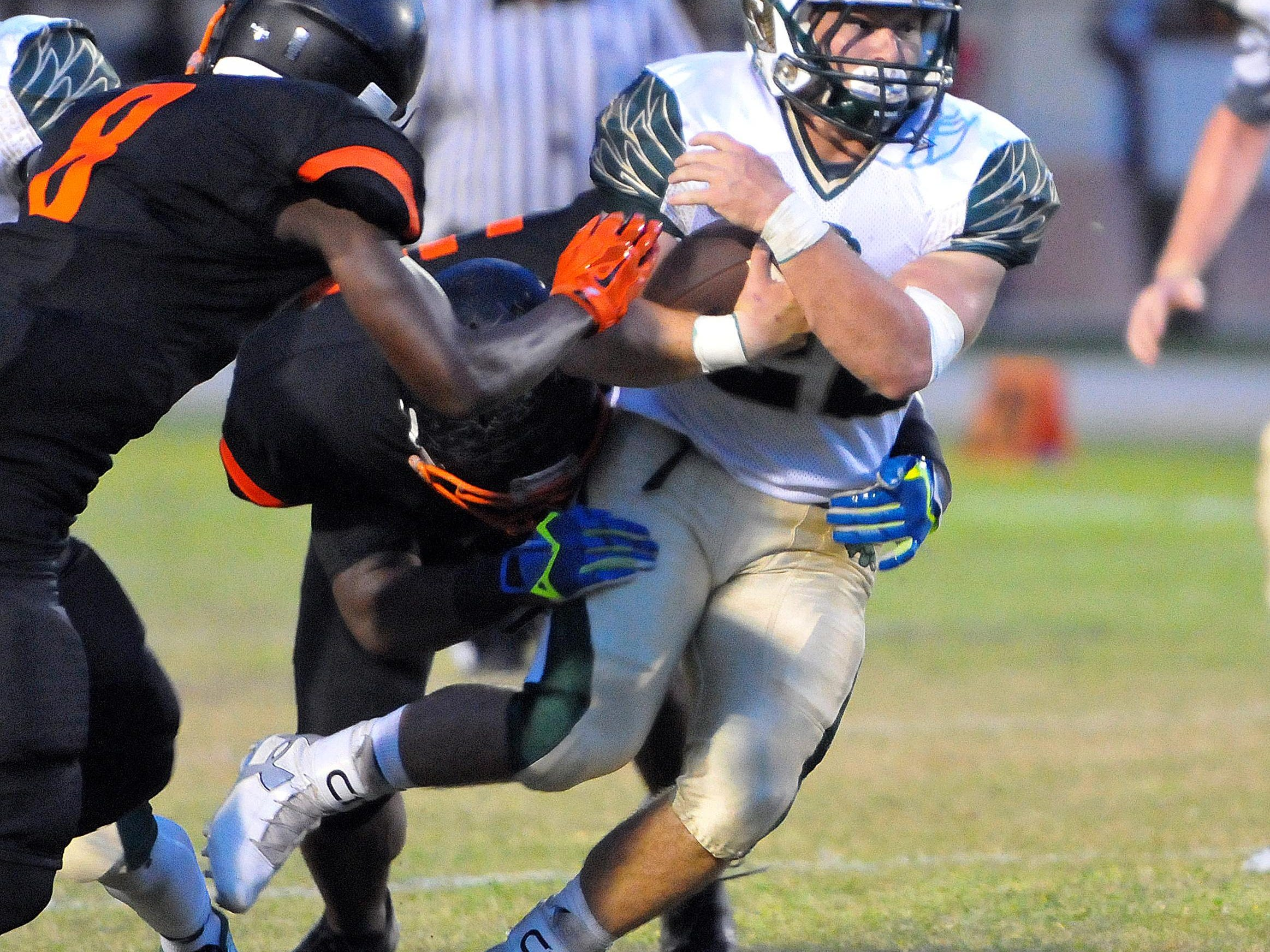 Viera High's Brennen DePlancke picks up some nice yards during Friday night's game against Cocoa High at Tiger Stadium.