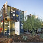 Sixteen shipping containers, shown on Thursday, Nov. 12, 2015, have been turned into apartments at 12th and Grand avenues in downtown Phoenix.