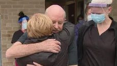 Dennis McMahan hugs family members after fighting COVID-19 since April.