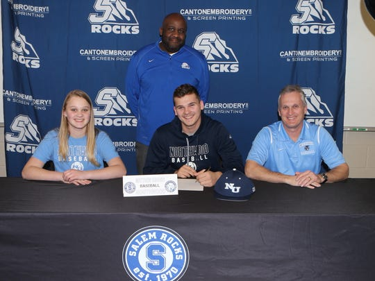 Salem baseball player Matt Brooks (seated, center) will play baseball in college at Northwood University. Flanking Brooks are his parents; also pictured is Salem baseball coach John Wright (standing).