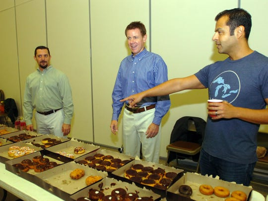 George Ostrowski (left) and Tim Dwyer and Rez Sazgari, members of the Proud Dads Club at Greenfield Elementary, furnish doughnuts, yogurt, juice and coffee at the breakfast.
