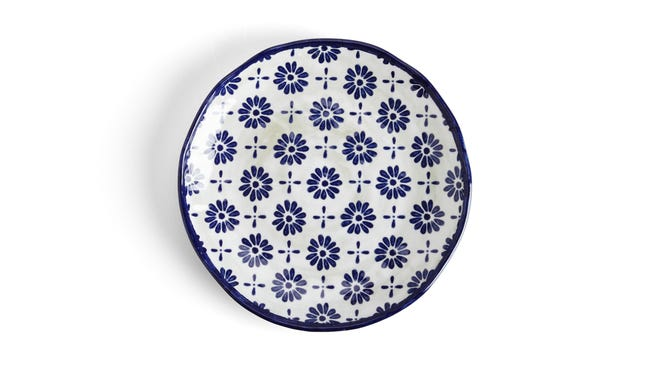A a floral-printed ceramic plate, a farmhouse and cottage style has a modern twist.