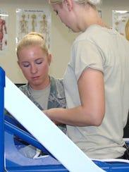 Senior Airman Kaitlyn Callahan does physical therapy
