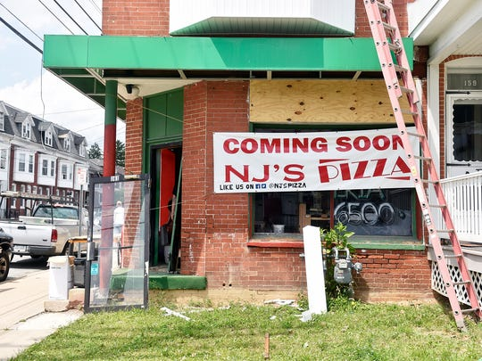 The exterior of NJ's Pizza on West Jackson Street is shown recently in York. Best friends Nathaniel Small and Nathan Shortlidge, who are also cousins by marriage, will serve New York-style pizza from their takeout restaurant NJ's Pizza, which they plan to open before the end of the summer.