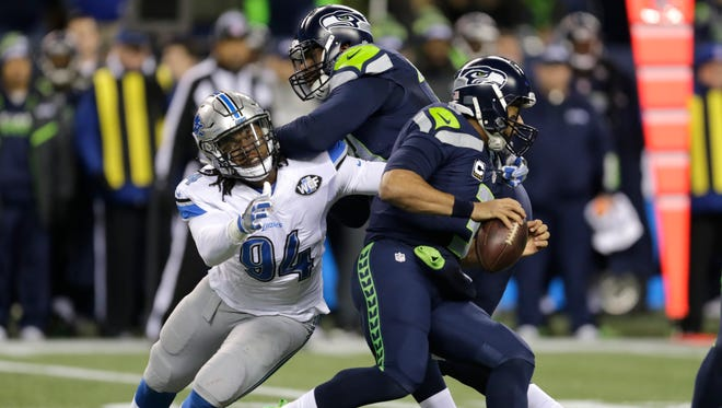 Lions defensive end Ziggy Ansah pressures Seahawks quarterback Russell Wilson in the NFC wild-card game Jan. 7, 2017 in Seattle.