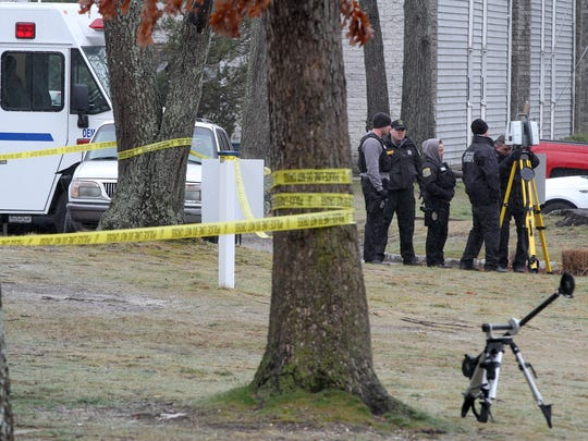 Ocean County Sheriffs Department CSI officers take measurements outside 190  Edgewood Drive in Toms River Tuesday, March 14, 2017, where a fatal police officer involved shooting occurred.