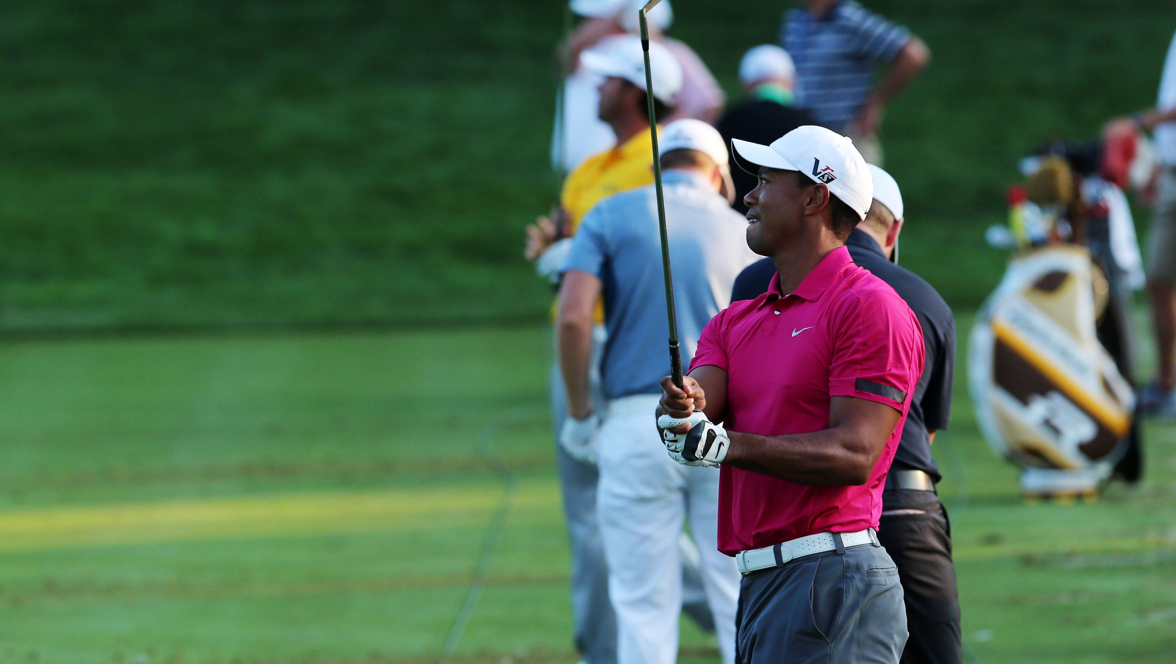 Tiger Woods practice on the practice range during the practice round of the 95th PGA Championship at Oak Hill Country Club.