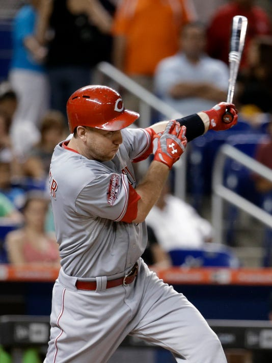 Cincinnati Reds' Todd Frazier follows through on a single in the fifth inning of a baseball game against the Miami Marlins, Thursday, July 9, 2015, in Miami. (AP Photo/Lynne Sladky)