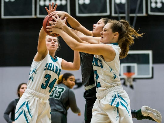 Gulf Coast juniors Maycie Macdonald, left, and Rhegan Venvertloh retrieve the rebound against Lakewood Ranch during the Class 8A regional semifinal at Gulf Coast High on Tuesday, Feb. 14, 2017. Gulf Coast beat Lakewood Ranch in overtime with a final score of 72-66.
