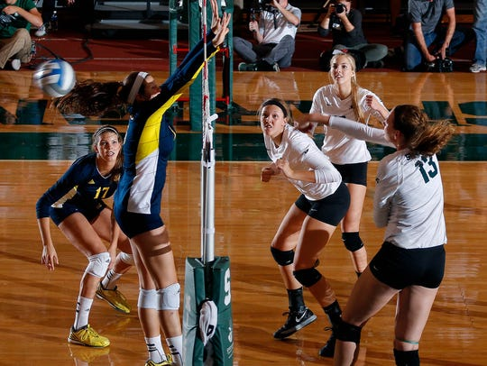 Michigan State's Brooke Kranda (13) hits a kill against
