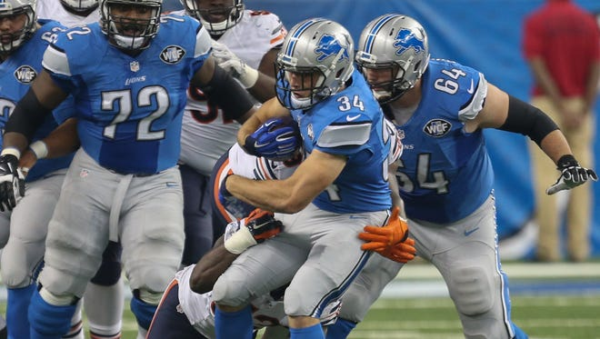 Detroit Lions running back Zach Zenner runs the ball against the Chicago Bears on Sunday, Oct. 18, 2015, at Ford Field in Detroit.