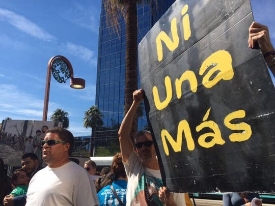About 100 people gathered outside the U.S. Immigration and Customs Enforcement office in central Phoenix in support of Guadalupe Garcia de Rayos on Feb. 8, 2017.