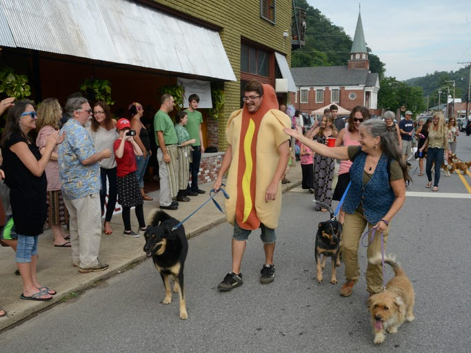 Sunday Frame will take a look  Marshall's Main Street Dog Daze Parade last Friday evening, one in a series of events to bring visitors and revive the town. John Coutlakis/8/8/14