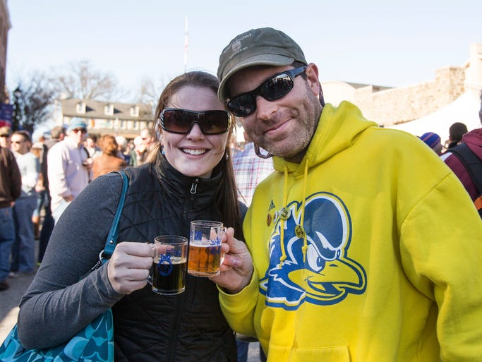WINTERFEST: Enjoying the warmest weather the area's had in a while are Kelly McDevitt and Matthew Delaney, of Newark, at Winterfest in Kennett Square, Pa., on Saturday.