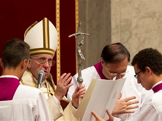 Pope Francis delivers his blessing at the end of a prayer on the occasion of the World Day of the Creation's care in St. Peter's Basilica at the Vatican, Tuesday, Sept. 1, 2015.