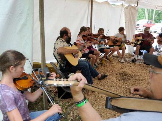 Attendees participate in a workshop in August 2014 at the Minnesota Bluegrass and Old-Time Music Festival, which features music and workshops at El Rancho Manana in Richmond.