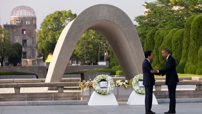 U.S. President Barack Obama (right) and Japanese Prime Minister Shinzo Abe shake hands May 27, 2016, during a wreath-laying ceremony at the cenotaph at Hiroshima Peace Memorial Park in Hiroshima, Japan Obama became the first sitting U.S. president to visit the site of the world's first atomic bomb attack, bringing global attention both to survivors and to his unfulfilled vision of a world without nuclear weapons. Atomic Bomb Dome is seen in the background.