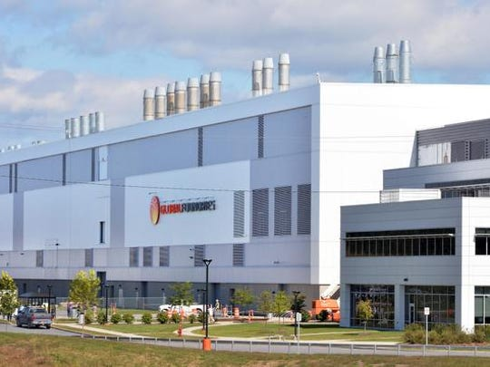 This Sept. 22, 2014 photo shows the GlobalFoundries campus in Malta, N.Y. IBM on Oct. 20, 2014 said it will pay $1.5 billion to GlobalFoundries in order to shed its costly chip division. (AP Photo/The Albany Times Union, John Carl D'Annibale)  TROY, SCHENECTADY; SARATOGA SPRINGS; ALBANY OUT
