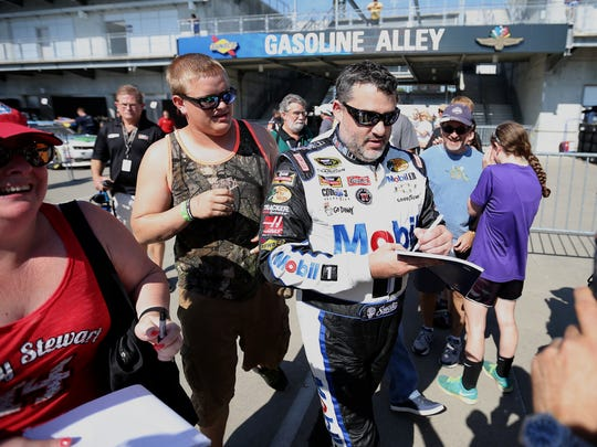 Tony Stewart signs autographs for fans following the first practice at the Brickyard, July 24, 2015, at the Indianapolis Motor Speedway.