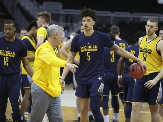 Michigan forward D.J. Wilson (5) goes through drills during practice at the NCAA Midwest Regional on Wednesday, March 22, 2017, at the Sprint Center in Kansas City, Mo.