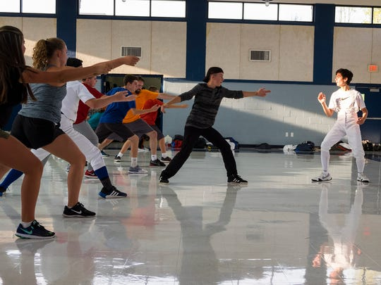 Ruben Garcia, 15, right, leads a warm-up at the Blue Water Fencing Club Sept. 11. Ruben was one of several students in the club who participated in a competition in Canton, Mich., where he had an opportunity to spar against fencers from around the country, including several Olympians.